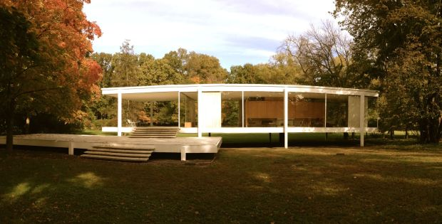 The Farnsworth House in Plano, Illinois designed by Mies van der Rohe next to the Fox river.  The house was constructed on steel stilts to save the building from flooding.