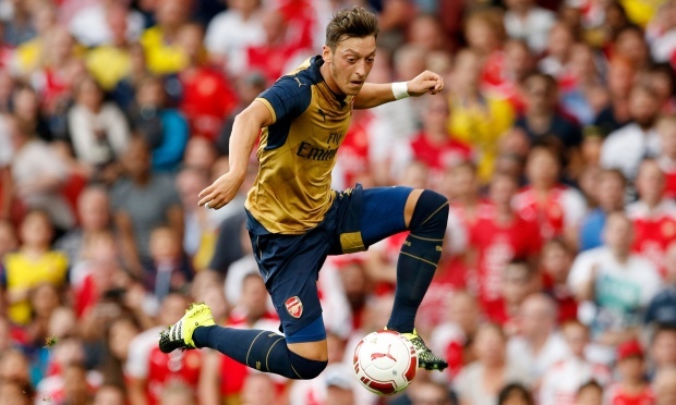 It is time for Mesut Ozil to 'design the game' according to his Arsenal manager, Arsene Wenger.